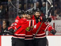 Left to right, Sean Durzi, Nick Suzuki, and Jonah Gadjovich celebrate a goal. Suzuki and Gadjovich were named to Team Canada's final selection camp roster in advance of the World Junior Championships. FILE PHOTO