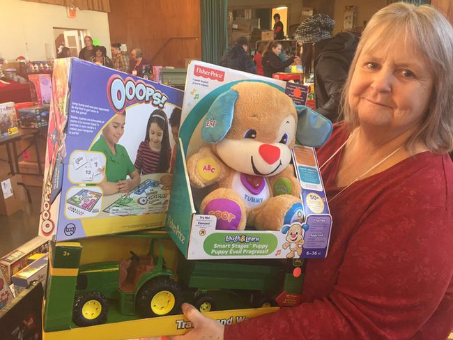 Christmas Place volunteer Cheryl Decoopman said she and her family all volunteer at the charitable organization that allows parents to purchase affordable gifts at Christmas. (HEATHER RIVERS/SENTINEL-REVIEW)