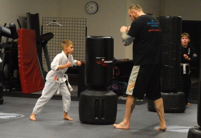 Co-founder of Bowen Brazilian Jiu Jitsu James Murray, right, guides Alexander Ainscow through a routine at his downtown St. Thomas gym. Ainscow is one of more than 70 children enrolled in the gym's shin atemi program, still only four years old. (Louis Pin // Times-Journal)