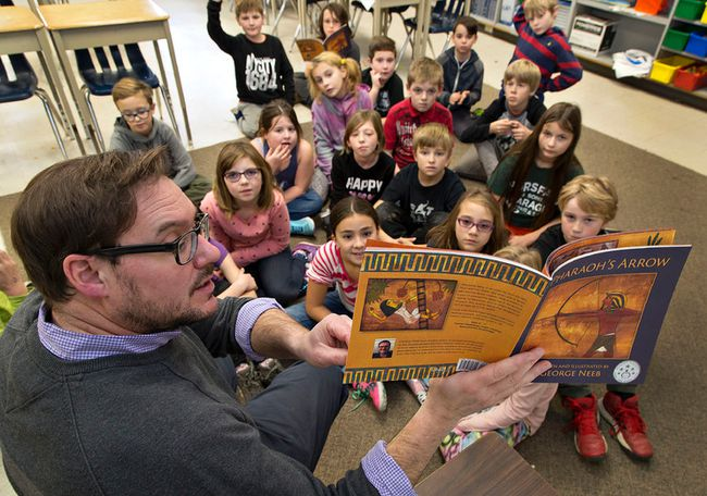 George Neeb, a Grade 4 teacher at North Ward School in Paris, reads on Wednesday from Pharaoh's Arrow, a book he wrote and illustrated. (Brian Thompson/The Expositor