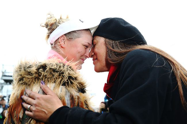 Brooke Henderson of Canada receives a traditional Maori hongi after winning the New Zealand Women's Open trophy by MC Kim during day five of the New Zealand Women's Open at Windross Farm on October 2, 2017 in Auckland, New Zealand.  (Photo by Hannah Peters/Getty Images)
