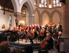 Jack Evans/For The Intelligencer The string ensemble Carpe Diem, from the Marmora area, is seated in front of the Belleville Choral Society's approximately 50 voices in St. Michael's Church Sunday afternoon