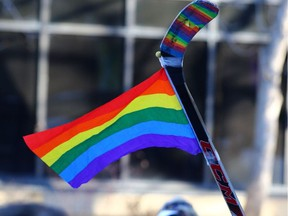 Photo by Gavin Young Postmedia Network  A rainbow flag and hockey stick added colour to a rally in support of gay straight alliances (GSA's) and Bill 24 at McDougall Centre in downtown Calgary on Nov. 12, 2017.