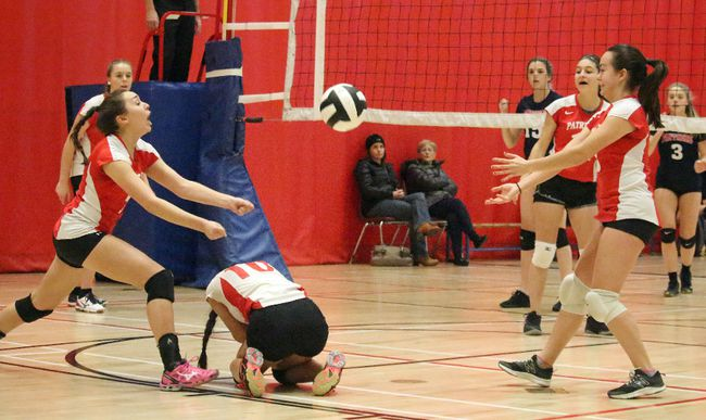 Emilie Pinard lunges for the ball after an Emilie Lalancette (10) dig during SD&G senior girls volleyball action at CCVS on Thursday. At right is Janell Forget. 