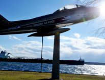 The laker John J. Boland makes its way along a windy St. Lawrence River as the Sabre Jet stands on Blockhouse Island on Wednesday. (RONALD ZAJAC/The Recorder and Times)
