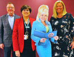 The Norfolk County Public Library announced a partnership Thursday with the Dolly Parton's Imagination Library program, one that allows community members to provide one age-appropriate book to youngsters in the area each month until the age of five. Posing with a life-sized cutout of Dolly are, from left, library supporter Phil Race, library CEO Heather King, and Imagination Library Ontario director Jeanne Smitiuch of Brantford. JACOB ROBINSON/Simcoe Reformer
