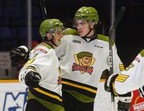 North Bay Battalion forward Justin Brazeau, right, celebrates with Cam Dineen after the Arizona Coyotes blueliner scored a powerplay goal in the third period against the Mississuaga Steelheads at Memorial Gardens, Thursday. Dave Dale / The Nugget