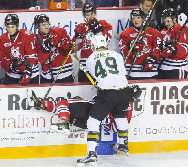 Max Jones of the London Knights checks Danial Singer of the Niagara IceDogs into the boards in OHL action at the Meridian Centre in St. Catharines on Thursday, December 7, 2017. (Julie Jocsak/ St. Catharines Standard)