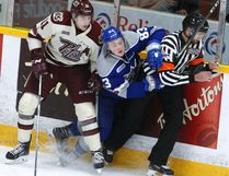 Peterborough Petes' Zach Gallant checks Sudbury Wolves' Zack Malik into a referee during second period OHL action on Thursday December 7, 2017 at the Memorial Centre in Peterborough, Ont. CLIFFORD SKARSTEDT/PETERBOROUGH EXAMINER