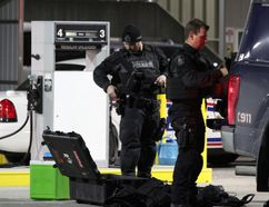 Tactical officers from Waterloo regional police pack up their equipment Friday about 12:15 a.m. after assisting London police in dealing with a distressed officer inside London headquarters Thursday. (DALE CARRUTHERS, The London Free Press)