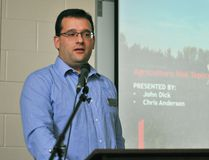 Chris Anderson, a senior advisor at BDO Canada's Chatham office, speaks about how upcoming tax changes will affect farmers during the Kent Federation of Agriculture's annual general meeting at the Ridgetown campus of the University of Guelph on Thursday. (Tom Morrison/Postmedia Network)