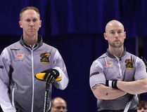 Skip Brad Jacobs and third Ryan Fry look on during their team's loss to Team Epping at the 2017 Roar of the Rings Canadian Olympic Trials in Ottawa on Friday, Dec. 8, 2017. THE CANADIAN PRESS/Justin Tang