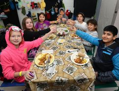 These smiling diners — clockwise from left, Hailey Murley, Erin Kennedy, Sky Doxtator, Zainab Alkhwaiter, Antonia Martinez, Neelaa Doxtator and Ubaidullah Badvi — are just some of the children who benefit from the Boys and Girls Club of London, which is still accepting donations for its 12 Days of Christmas campaign. (MORRIS LAMONT, The London Free Press)