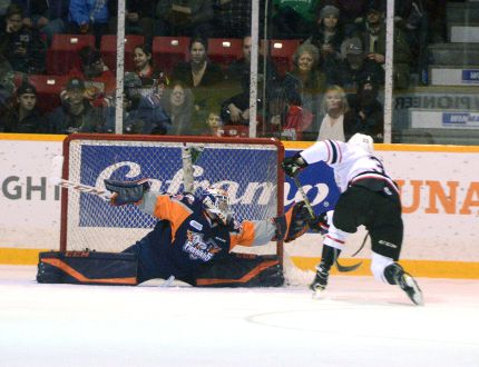 The Flint Firebird's Garrett Forrest sprawls out to make the glove save and steal a goal from Owen Sound's Brady Lyle during the second period of the Attack's 5-4 win over the Firebirds on Saturday night at the Harry Lumley Bayshore Community Centre. (Greg Cowan/The Sun Times/The Postmedia Network)