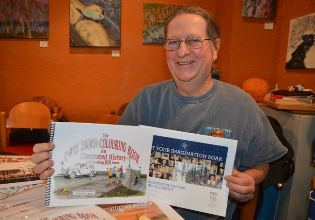 Local history colouring book illustrator Ken Thornburn at the 32nd annual Authors' Open House at The Ginger Press on Saturday in Owen Sound. (Scott Dunn/The Sun Times)