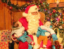 Ingersoll locals and seven month old twins Archer Forget, left, and Vander Forget, right, pose with Santa Claus at the Festival of Lights and Santa's Festival Village at the Ingersoll Cheese and Agricultural Museum in Ingersoll, Ont. on Friday December 8, 2017. Greg Colgan/Woodstock Sentinel-Review/Postmedia Network