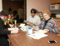 Sarnia-Lambton Amnesty Action Group members Chris Temple (left), Subash Prasad (centre) and Thea DeGroot write letters of hope to imprisoned activists on Dec. 6. CARL HNATYSHYN/SARNIA THIS WEEK