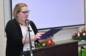Kent Federation of Agriculture director Katrina Sterling accepts the Ed Campbell Memorial Award for Director of the Year during the KFA's annual general meeting at the Ridgetown Campus of the University of Guelph on Dec. 7.