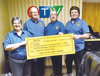 Photo supplied Elly Charette, Charles McClare, Joe Charette and Grant Lewis representing the Lions Club of Espanola were in Sudbury, on Saturday, Dec. 2, to present a cheque for $750 to the annual Children's Christmas Telethon and to help staff the phone lines.