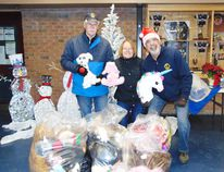 Photo by Helen Morley/For The Mid-North Monitor Bill Ouderkirk, Sue Lebel and Dario Laurenti collected the teddy bears from the Teddy Bear Toss. They ended up with three full bags of toys in all shapes and sizes. After they were counted it was determined to be just over 100 plush toys.