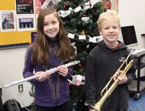 Grade 5 student Monica Favreau and Grade 6 student Tanner Main, both from St. Louis School, are two of more than 40 students who have been learning to play their instruments in the Junior Winds ensemble for the past six weeks. The Junior Winds had their first performance at the St. Thomas Aquinas Christmas concert on Wednesday, Dec. 6. KATHLEEN CHARLEBOIS/DAILY MINER AND NEWS