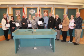 A group of St. Clair Township residents received Good Neighbours certificates prior to the Dec. 4 council meeting. From left are: Liz Lovell, Lyla Kennedy, Peggy Jenkins, Peter Cassel, Bev Cassel, Cel Simpson, Ken Simpson, Penny Miller, Doug Miller, Mayor Steve Arnold, Dave Robinson, John Wilson, Colleen Flesher and John Flesher (two-time winners). CARL HNATYSHYN/SARNIA THIS WEEK