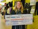 Erin Stewart/For The Intelligencer Holly Gunawardena, winner of the 2017 Shop Local, Win Local contest, was all smiles Tuesday as she picked up her $2,800 travel voucher from Urban Liquidation and Trent Travel.