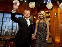 "FILE - In this Friday, Nov. 18, 2011, file photo, Regis Philbin and Kelly Ripa appear on Regis' farewell episode of ""Live! with Regis and Kelly"", in New York. Charles Sykes / ASSOCIATED PRESS"