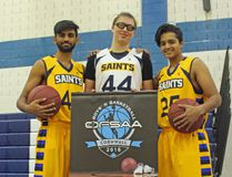 From left, Gobi Mohanathas, Jacob Secenj and Qasim Ali, three of the veterans on the St. Lawrence Saints, with the newly-arrived OFSAA banner. The Saints will host the senior boys basketball A OFSAA championships this year. Kevin Gould/Cornwall Standard-Freeholder