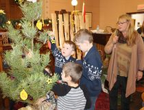 Lucknow United Church held the Sunday School Pageant on Sunday December 10, 2017 which highlighted the symbols of Christmas. Children and all in attendance participated in identifying the symbols as the children placed them on or around the Christmas tree. The children of the Lucknow Sunday School made butterfly hand paintings that would be kept in the church for years to come. Pictured: Ayden James and his brother Emmett hang symbols of Christmas on the Christmas tree and Ethan Mali, as Rev. Lynne Wilson looks on.