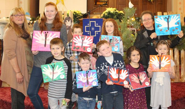 Lucknow United Church held the Sunday School Pageant on Sunday December 10, 2017 which highlighted the symbols of Christmas. Children and all in attendance participated in identifying the symbols as the children placed them on or around the Christmas tree. Pictured: L-R: Doreen Mali, Emmaly Brown, Ethan Mali, Hunter Greig, Emmett James, Ayden James, Alexis Greig, Ashton Priestap, Macey Farrish and Rev. Lynne Wilson hold up the butterfly hand paintings made by the Sunday School students. (Ryan Berry/ Kincardine News and Lucknow Sentinel)