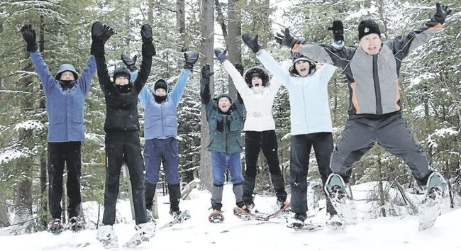Exuberant winter lovers have a ball at Frontenac Provincial Park. (Ontario Parks)