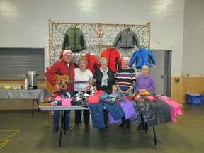A folk musical group/gathering launched a fundraiser directed towards the Huron County Christmas Bureau in Seaforth.  Names as followed, from left to right: Tom Melady, June Zettel, Elaine Floyd, Lois Scoins and Honee Scott. (Submitted photo)