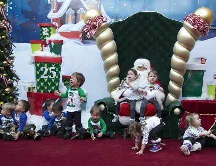 Santa Claus greets five sets of twins, whose ages range from 23-25 months, prior to a chaotic photo shoot at White Oaks Mall in London, Ont. on Wednesday December 13, 2017. The children are Leo and Alex Mihaljevic, Carter and Caiden Carmichael, Austin and Mason Dunlap-Gray, Katrina and Victoria Hale, and Lexi and Ashlyn Fedorow. The moms and tots meet socially once a month. (DEREK RUTTAN, The London Free Press)