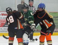 Madison Pawis of Holy Trinity squeezes through a pair of Seaway defenders, right before scoring as the final seconds ticked away in Chesterville on Thursday. The goal made it 6-1, the Falcons defeating the Seaway Spartans on the first day of SD&G girls high school hockey action. Kevin Gould/Cornwall Standard-Freeholder
