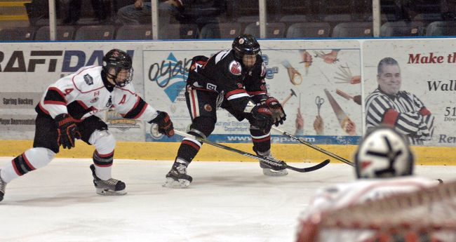 Brantford 99ers forward Kyle West reaches for a puck on Thursday at the Wayne Gretzky Sports Centre against the Listowel Cyclones in a Greater Ontario Junior Hockey League Mid-Western Conference game. (Brian Smiley/The Expositor)