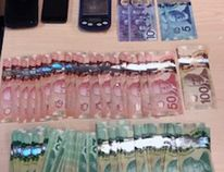 Cash, scale and cell phones seized by Kingston Police from two Ottawa women in Kingston, Ont. on Thursday December 14, 2017. Supplied photo