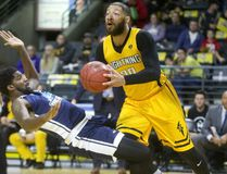 London Lightning's Royce White knocks down CJ Washington of the Halifax Hurricane on a drive to the basket during the Lightning's home opener on Sunday November 26, 2017 at Budweiser Gardens. (MIKE HENSEN, The London Free Press)