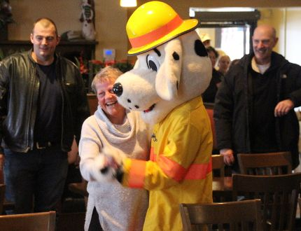<p>Lori Froats never expected to end up dancing with Sparky the Fire Dog when she went out for lunch with friends to celebrate her birthday. But that's what happened when a group of singing firefighters arrived at Philo's Restaurant as part of Sparky's Toy Drive on Friday December 15, 2017 in Cornwall, Ont. </p><p> Alan S. Hale/Cornwall Standard-Freeholder/Postmedia Network
