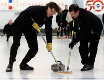Guy Paquette, left, second for the Granite Club's Mark Brown rink, and fifth Luc Gelinas, sweep Brown's shot during the Northern Ontario Senior Men's Provincial Championship's East Region qualifying tournament in North Bay on the weekend. Brown's rink and four more out of the eight that started move on to the provincials being held at the Tarentorus Sports Club in Sault Ste Marie, Jan. 24-28. Dave Dale / The Nugget