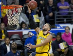 Garret Williamson takes flight to score two points during the London Lightning's victory over the St. John's Edge, 116-103, in London, Ont. on Sunday December 17, 2017. (DEREK RUTTAN, The London Free Press)