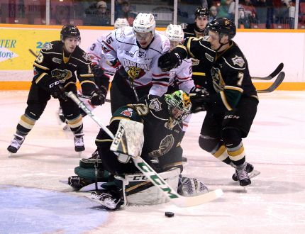 Owen Sound forward Matthew Struthers and London Knights defenceman Shane Collins battle in front of Knights goalie Jospeh Raaymakers during the Knights' 1-0 win over the Attack Sunday in Owen Sound. (Greg Cowan/Postmedia News)