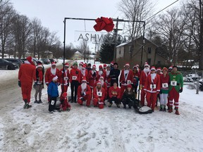 Group shot of some of the participants in the five kilometre run. This year there were over 30 participants in the annual Santa Run. (Contributed photo)
