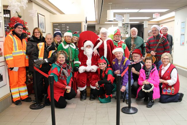 Santa Claus, Mrs. Claus and their elves were at the Cochrane Station with members of the Cochrane Lions Club and Ontario Northland employees.
