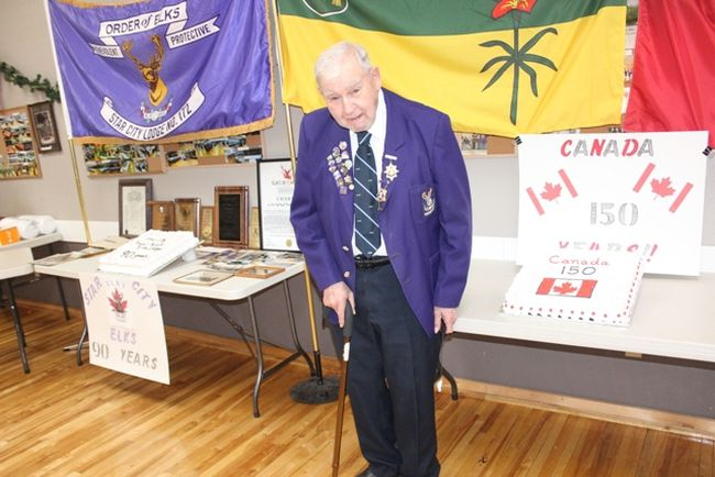 Longtime Star City Elk George Shipley was the ceremonial cake cutter as the Star City Elks Lodge celebrated their 90th Anniversary and Canada 150 on Sunday, December 17 at the Elks Hall in Star City.