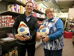 Stubbe's BrandSource Home Furnishings recently donated 35 turkeys to the Helping Hand Food Bank. Joan Clarkson, Helping Hand Food Bank coordinator (on the right), thanks Gerrard Stubbe for the donation. (Chris Abbott/Tillsonburg News)