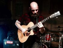 Canmore-based finger style instrumental acoustic guitarist Kyle Pullan performs on the final night of Battle of the Bands at Tommy's Neighbourhood Pub in Banff on Wednesday. (Supplied)