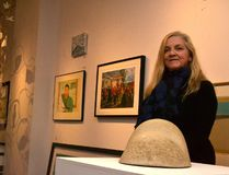 Cindy Hubert, owner and curator of Agora Gallery in Stratford, poses with some of the local talent on display for the gallery's The Canadian Landscape: A Wider View Exhibition. (Galen Simmons/The Beacon Herald/Postmedia Network)