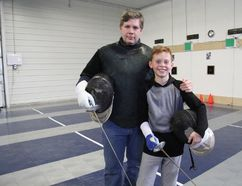 Stratford Fencing Club head coach Darren Marks stands with young foilist Blake DeGroot inside the club's new 2,000-square-foot facility on Griffith Road. (Cory Smith/The Beacon Herald)