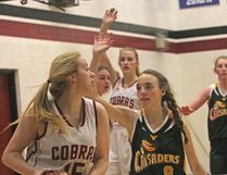 The Cochrane High Cobras senior girls' basketball team finished with a silver medal at the 10th Annual Cochrane Classic that took place Dec. 14-16 at Cochrane High, Bow Valley High and St. Timothy. Here, the Cobras beat Canmore High 68-30 in their opening game. Canmore went on to win the consolation bracket, while Cochrane lost in the finals to Wetaskiwin.